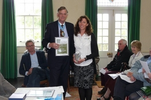 Ms Alex Tunnicliffe being presented with an Award by the High Sheriff