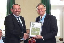 Paul Simpson receiving his club's award from IW High Sheriff, Ron Holland